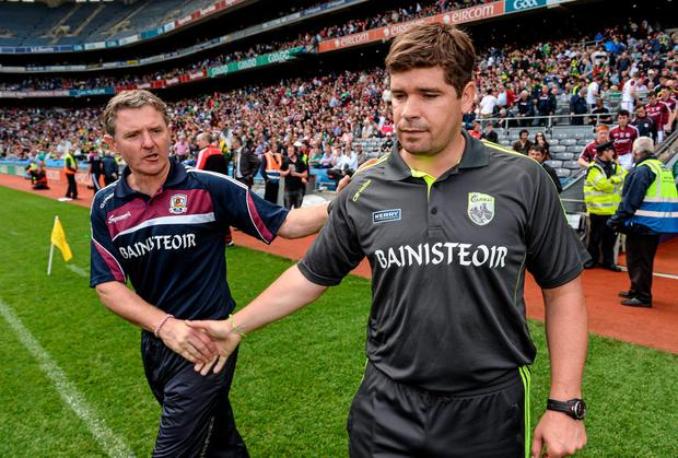 Kerry manager Eamonn Fitzmaurice (right) and Galway manager Alan Mulholland shake hands after the All-Ireland quarter-final between their sides at Croke Park. Photo: Stephen McCarthy / SPORTSFILE