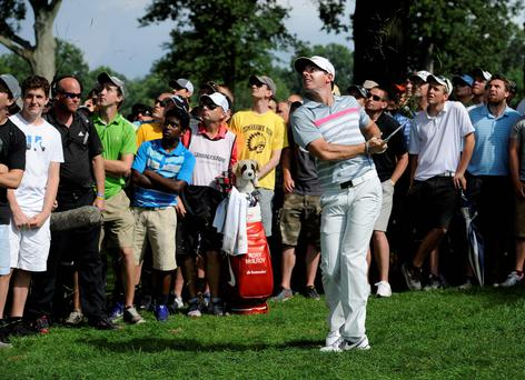 Rory McIlroy watches his shot from the rough on the eighth hole of the final round of the Bridgestone Invitational golf tournament. AP