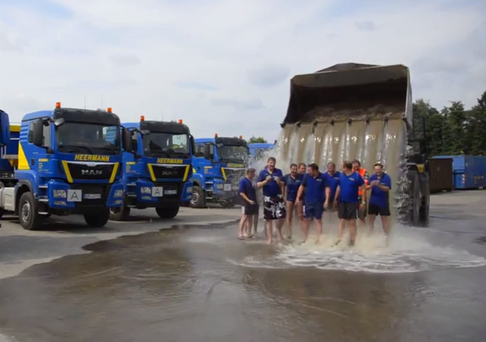 A different group successfully complete the Cold Water Challenge with a digger.
