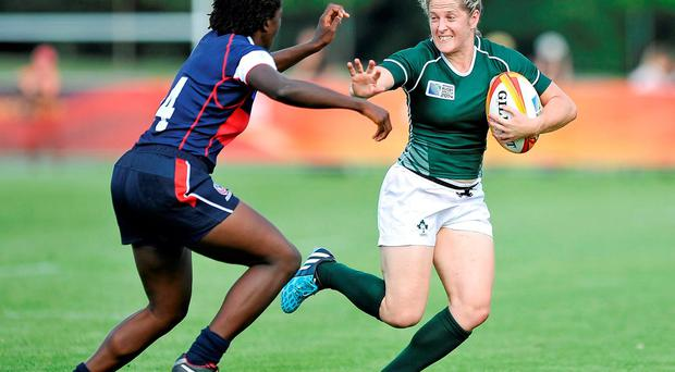 Ireland's Alison Miller evades a tackle from Vanesha McGee of the US during the Women's Rugby World Cup pool B clash in Paris. Photo: Aurélien Meunier / SPORTSFILE