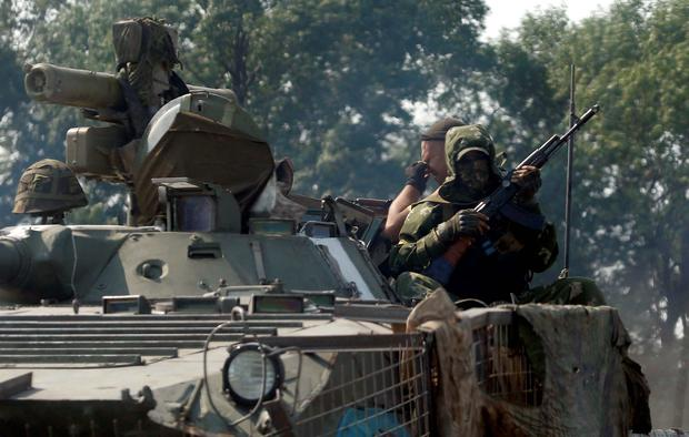 Ukrainian soldiers sit on an armoured vehicle near the town of Nikishino in the Donetsk region. Reuters