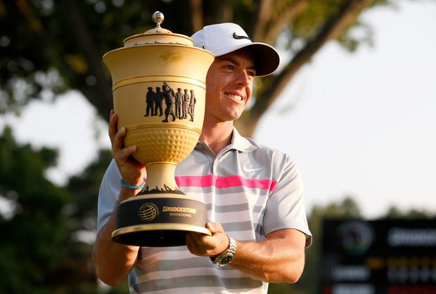 Rory McIlroy holds the Gary Player Cup trophy after winning the World Golf Championships Bridgestone Invitational at Firestone