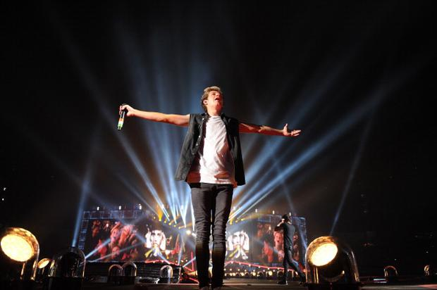 NEW YORK, NY - AUGUST 04: (EDITORIAL USE ONLY; NO COVERS; NO USE IN ANY MAGAZINE OR OTHER PUBLICATION BASED PREDOMINANTLY ON ONE DIRECTION OR ANY ONE OR MORE MEMBERS OF ONE DIRECTION) Niall Horan of One Direction performs onstage during the