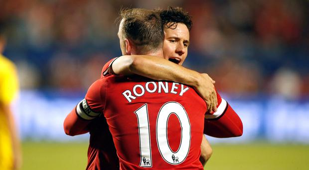 Aug 4, 2014; Miami Gardens, FL, USA; Manchester United midfielder Juan Mata congratulates forward Wayne Rooney (10) after his goal in the second half against Liverpool at Sun Life Stadium. Photo: Robert Mayer-USA TODAY Sports