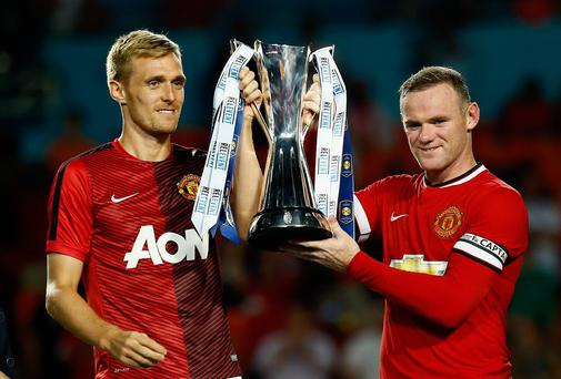 Darren Fletcher and Wayne Rooney lift the International Champions Cup after Manchester United's victory over Liverpool. Photo: Chris Trotman/Getty Images