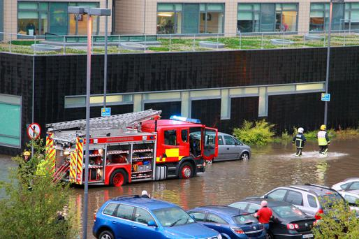 Letterkenny Fire Service tried to relieve the flood water at Letterkenny General Hospital last night as it flooded again following heavy rain. Photo Brian Mc Daid