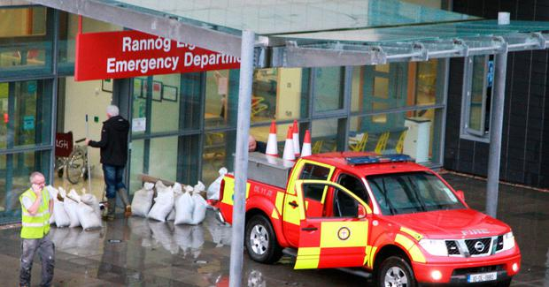 Staff and emergency crews at Letterkenny General Hospital as thy try to revert the water from the new emergency Department which was flood one year ago. Photo Brian McDaid