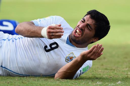 Suarez after biting Cheillini during the World Cup