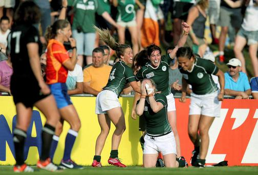 Ireland's Ashleigh Baxter, Nora Stapleton and Niamh Briggs celebrate at the final whistle after their World Cup Pool B victory over New Zealand in Paris. Photo: INPHO/Dan Sheridan