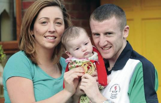 Gold winning Paddy Barnes is welcomed home by daughter Eireann and partner Mari