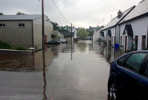 Pound street, Ramelton, was badly affected during Tuesday evening's flash flood with young members of the Ramelton Town Band having to be rescued from the community centre (on left).