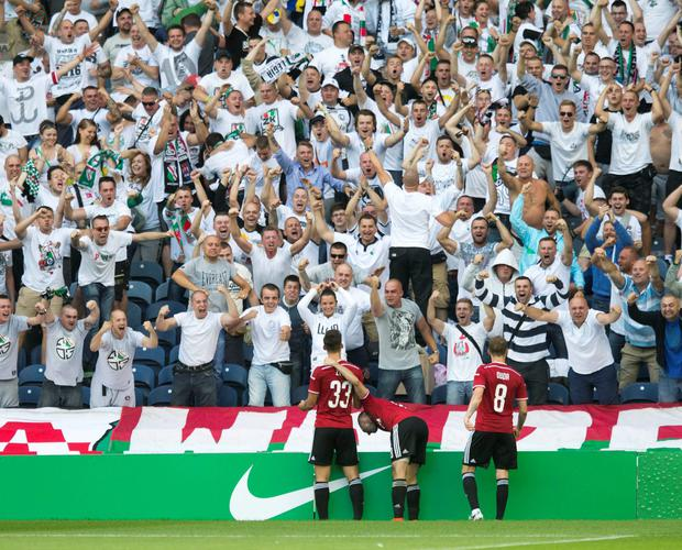 Legia Warsaw's Michal Zyro (left) celebrates his goal during the Champions League Qualifying at Murrayfield, Edinburgh. PRESS ASSOCIATION Photo. Picture date: Wednesday August 6, 2014. See PA story SOCCER Celtic. Photo credit should read: Jeff Holmes/PA Wire