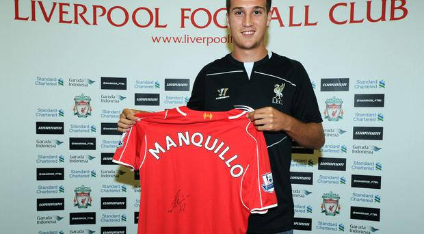 New Liverpool signing Javier Manquillo poses as he is unveiled at the club's Melwood training ground. Photo: Nick Taylor/Liverpool FC via Getty Images
