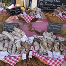 Sausages at a French market - Eilis O'Hanlon and her family return to France for the shopping.