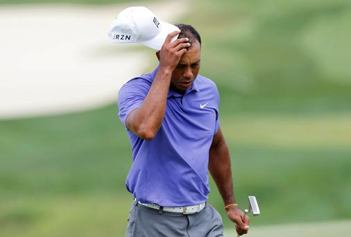 Tiger Woods reacts after finishing his first round
