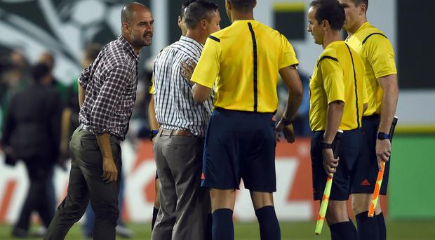 Bayern Munich Head coach Pep Guardiola argues with referee Jair Marrufo during the MLS All-Star game between the MLS All-Stars and FC Bayern Munich at Providence Park in Portland, Oregon. Photo credit: Lars Baron/Bongarts/Getty Images