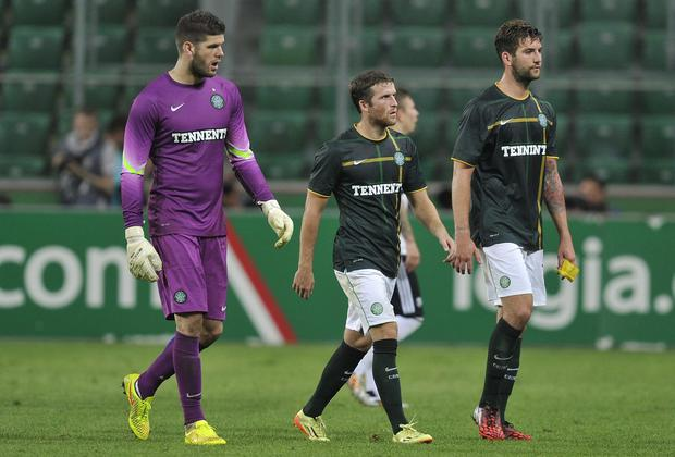 A dejected Fraser Forster, Adam Matthews and Charlie Mulgrew of Celtic leave the pitch after their Champions League qualifier defeat to Legia Warsaw. Photo credit: Piotr Hawalej/Getty Images