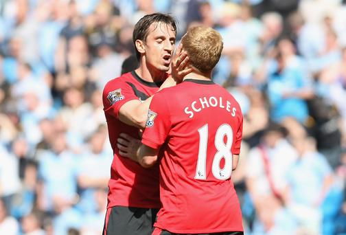 Paul Scholes is kissed by team-mate Gary Neville during Manchester United's 2010 victory over their city rivals
