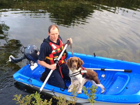 Max, the search dog donated by the Peggy Mangan foundation, takes to the canal in search of missing pensioner Thomas Kennedy. Photo: Dublin Civil Defence and the Peggy Mangan Foundation