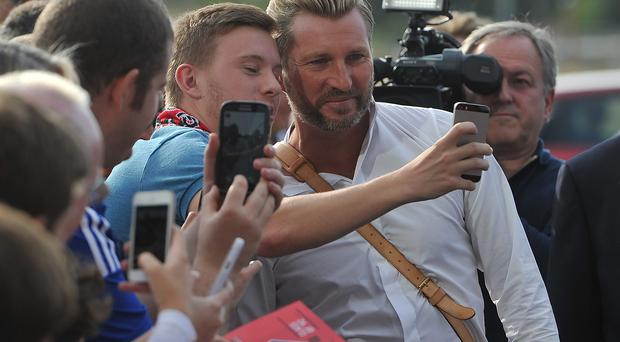 Robbie Savage stops to chat to fans during the pre-season friendly at the AJ Bell Stadium, Salford. PRESS ASSOCIATION Photo. Picture date: Thursday August 7, 2014. See PA story SOCCER Salford. Photo credit should read: Dave Howarth/PA Wire