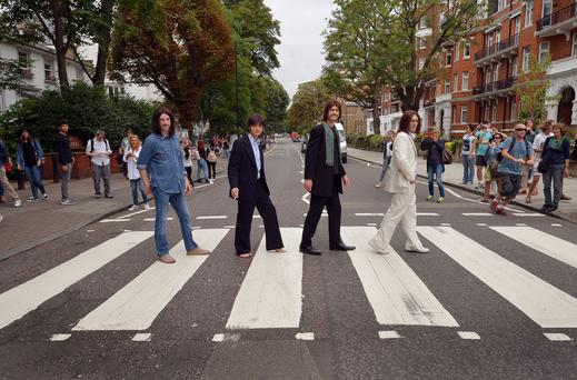The stars of the West End musical 'Let It Be' (from left) Paul Mannion, Manny Angeletti, Ben Lullingworth, and Michael Gagliano, recreate the Beatles' famous Abbey Road crossing