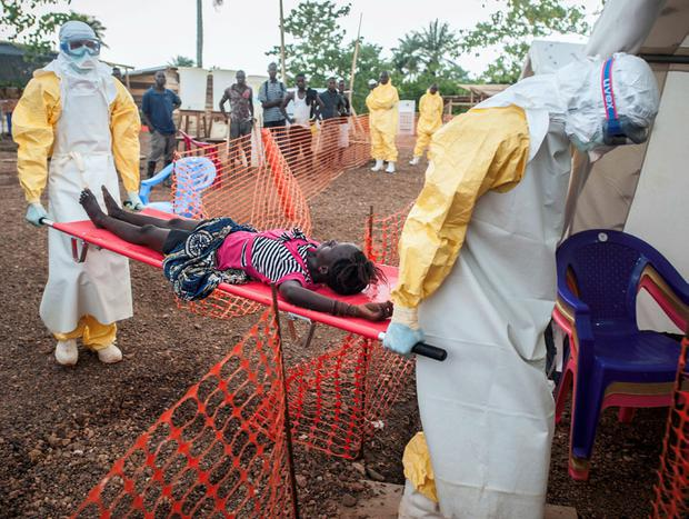 Outbreak: Medical staff treat an Ebola victim in Sierra Leone