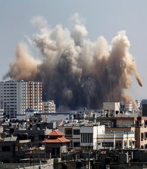 Smoke, dust and debris rise over Gaza City after an Israeli strike