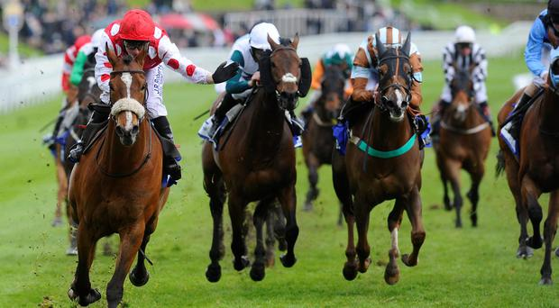 Stevie Donohoe riding Sir Maximilian (L) win The Stellar Group Handicap Stakes at Chester racecourse in May