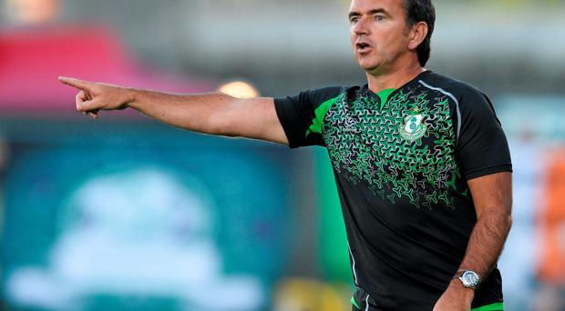 Pat Fenlon points the way for Shamrock Rovers at Tallaght Stadium. David Maher / SPORTSFILE