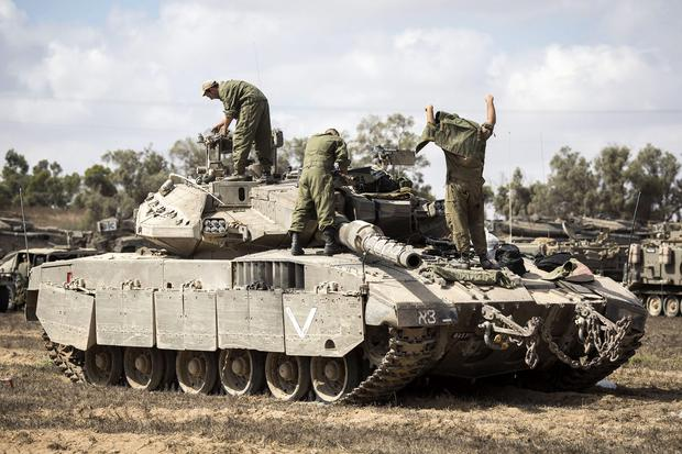 Israeli soldiers return from Gaza on August 3, 2014 near the border with Gaza, Israel. As Operation Protective Edge enters its 27th day, a large amount of Israeli ground troops are believed to have left the Gaza Strip. (Photo by Ilia Yefimovich/Getty Images)
