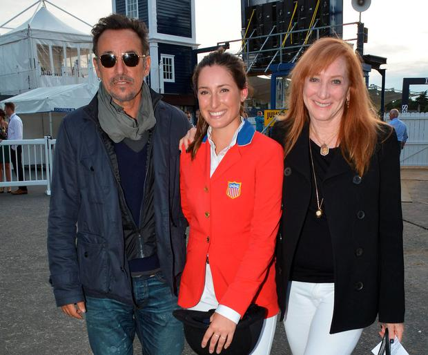 Proud parents Bruce Springsteen & Patti Scialfa pose with their daughter Jessica Springsteen who won her Class for the USA at the RDS Dublin Horse Show 2014