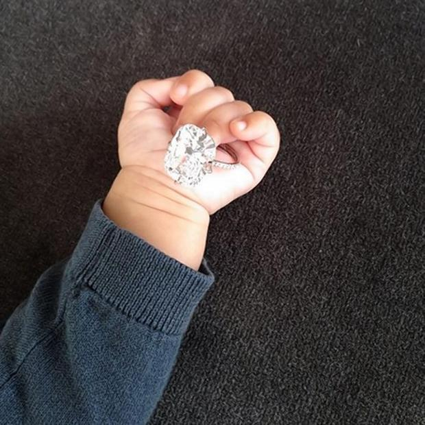 Little North holds her mother's ring