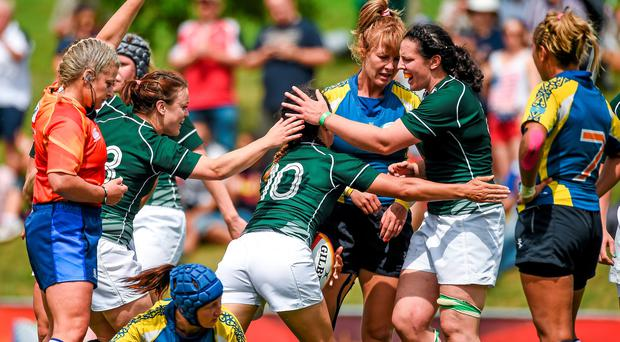 Tania Rosser, Ireland, celebrates with team-mates Lynne Cantwell, left, and Paula Fitzpatrick after scoring her side's second try