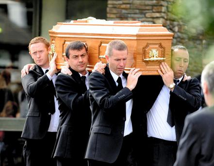 9-8-2014: Kerry footballer Colm 'Gooch' Cooper, back left, helps carry the remains of of his mother Maureen, at her funeral in the Church of the Resurection Killarney on Saturday morning. Picture by Don MacMonagle