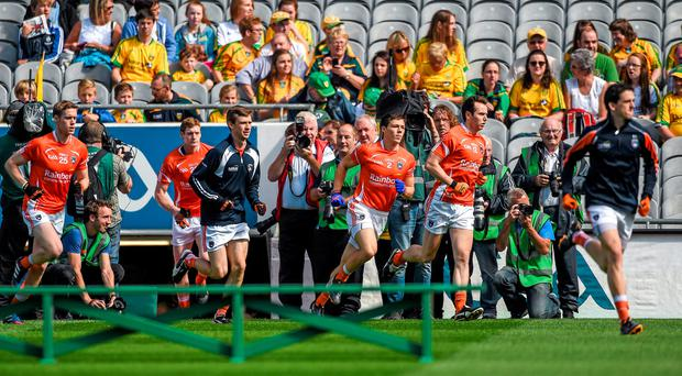 The Armagh team run out on to the pitch and subsequently refused to pose for a team photograph