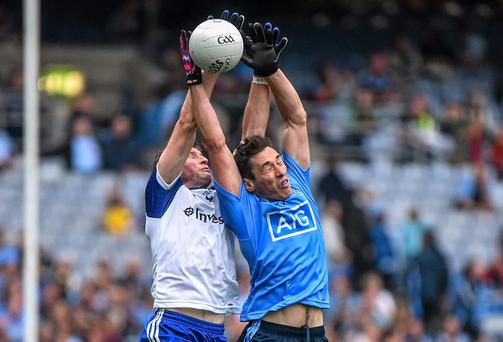 Dublin's Nicky Devereux and Monaghan's Darren Hughes battle for possession in Croke Park yesterday. Ramsey Cardy / SPORTSFILE