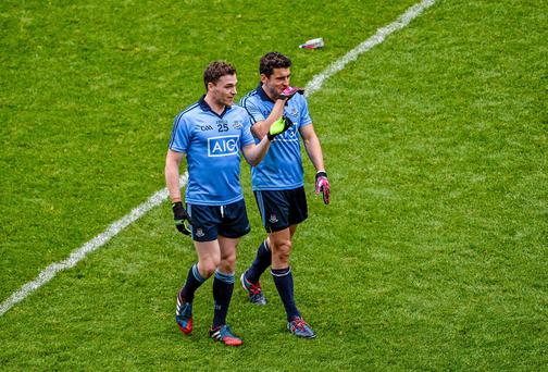 Dublin's Paddy Andrews, left, and Bernard Brogan smile as they leave the pitch after their quarter-final match against Monaghan. Every GAA supporter will now hope Donegal can make the semi-final a true contest. Dáire Brennan / SPORTSFILE