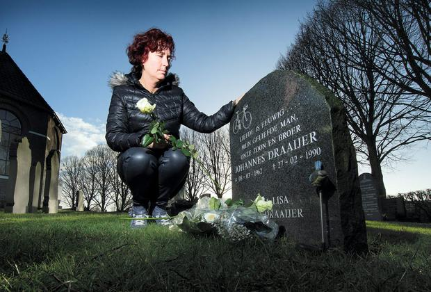 Annalisa Schmad at the grave of her late husband Johannes Draaijer in Sondel in the Netherlands