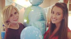 Holly Sweeney poses at her baby shower