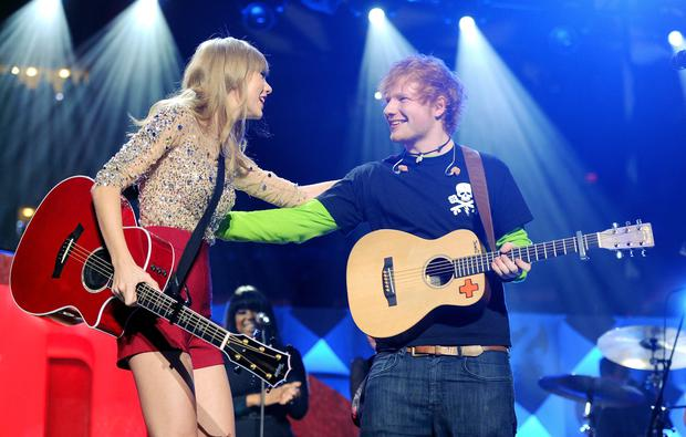 Singers Taylor Swift and Ed Sheeran perform together