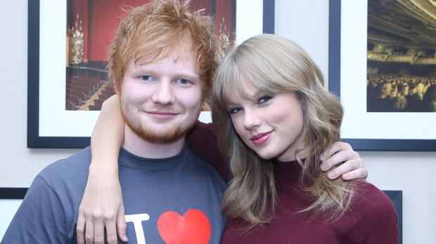 Ed Sheeran poses with Taylor Swift