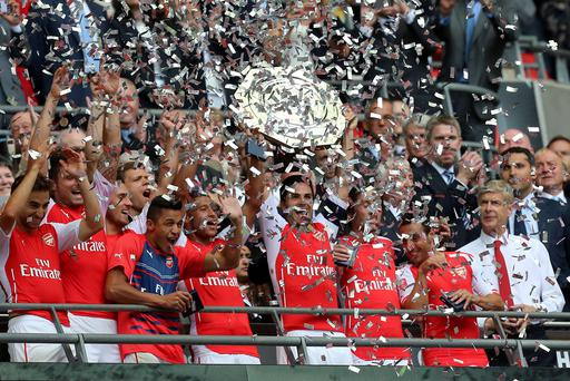 Arsenal's Mikel Arteta lifts the trophy on the balcony after victory over the Manchester City in the Community Shield at Wembley Stadium