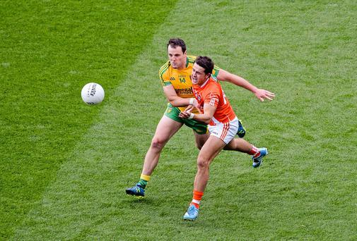 Stefan Campbell, Armagh, in action against Michael Murphy, Donegal