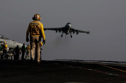 An F/A-18C Hornet coming from Iraq lands on the flight deck of the U.S. Navy aircraft carrier USS George H.W. Bush in the Persian Gulf. AP