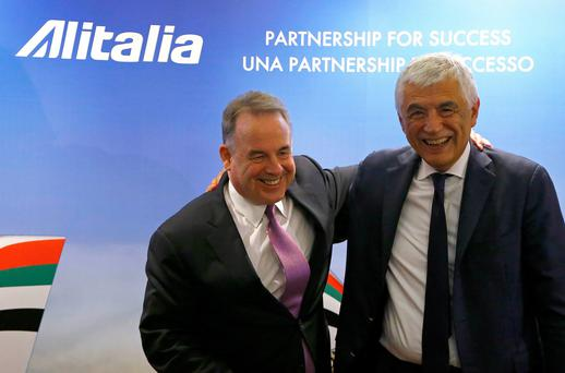 Etihad's Chief Executive Officer James Hogan (L) embraces Alitalia's Chief Executive Officer Gabriele Del Torchio as they arrive for a media conference in Rome.