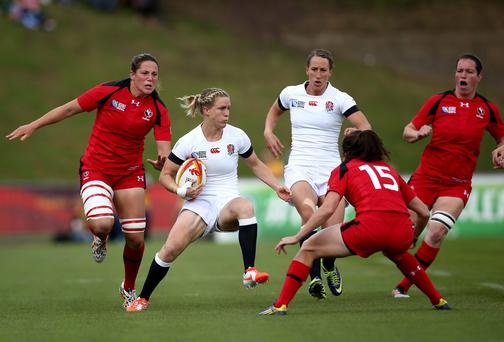 England's Danielle Waterman attempts to jink past Elissa Alarie of Canada during the Women's Rugby World Cup Pool A match. Photo: Jordan Mansfield/Getty Images