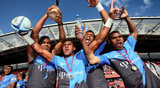 The Daveta team celebrate after winning the World Club 7s in Thomond Park last year. Photo: INPHO/James Crombie
