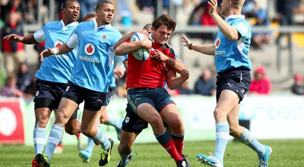 Munster's Ned Hodson is stopped in his tracks during his side's Limerick World Club 7s clash with the Vodacom Blue Bulls. Photo: INPHO/James Crombie