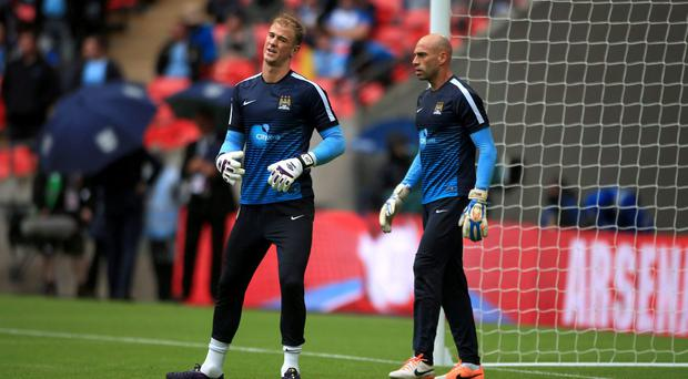 Manchester City goalkeeper Joe Hart in the warm-up with team-mate Willy Caballero. Photo: Nick Potts/PA Wire
