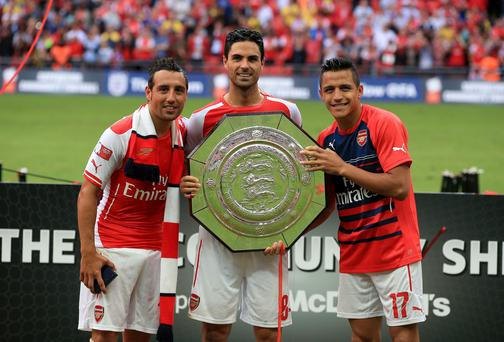 Arsenal captain Mikel Arteta (centre) celebrates with teammates Santi Cazorla (left) and Alexis Sanchez after winning the Community Shield. Photo: Nick Potts/PA Wire